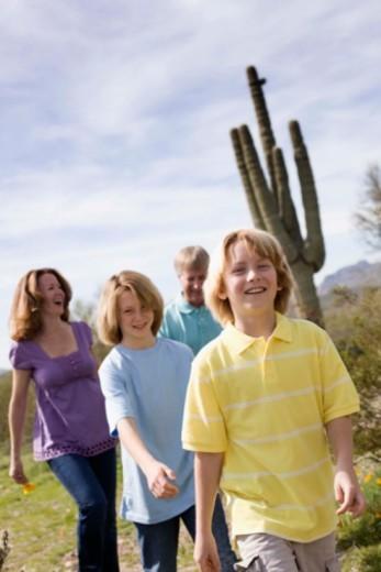 Family walking in desert, Arizona : Stock Photo