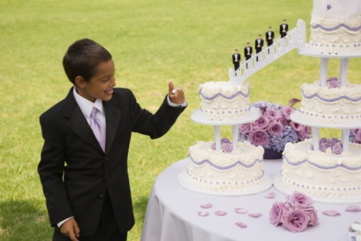 Boy eating cake : Stock Photo