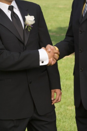 Men shaking hands : Stock Photo