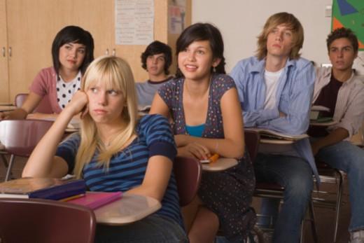 Bored teenage girl in classroom : Stock Photo