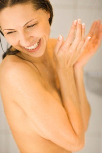 Smiling woman taking shower : Stock Photo