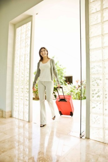 Woman with luggage : Stock Photo