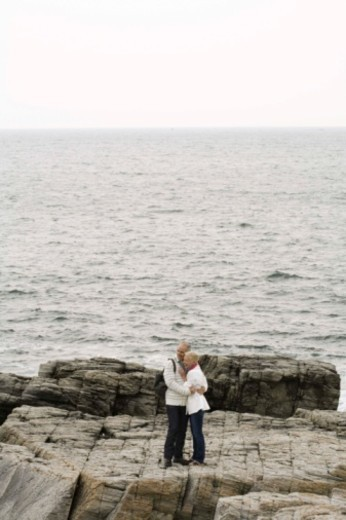 Couple embracing near shore : Stock Photo