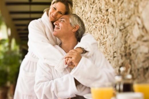 Couple having breakfast on hotel terrace : Stock Photo
