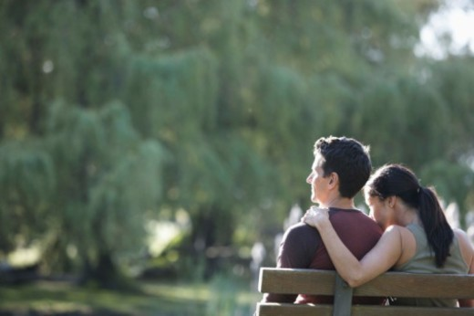 Stock Photo: 1555R-342471 Couple sitting on park bench