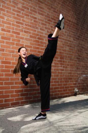 Girl doing martial arts : Stock Photo