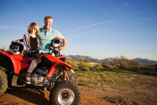 Stock Photo: 1555R-342848 Father and son by ATV, Arizona