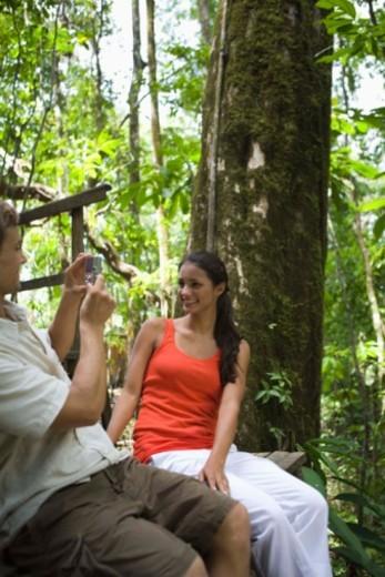 Couple taking picture in forest, Islas del Rosario, Colombia : Stock Photo