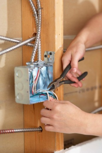 Stock Photo: 1555R-343525 Close-up of hands doing electrical wiring