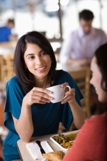 Stock Photo: 1555R-344187 Women talking in cafe