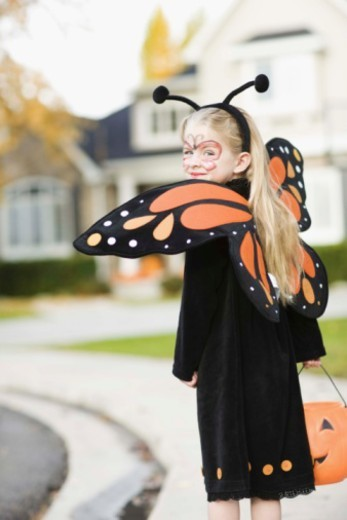 Girl in Halloween costume : Stock Photo