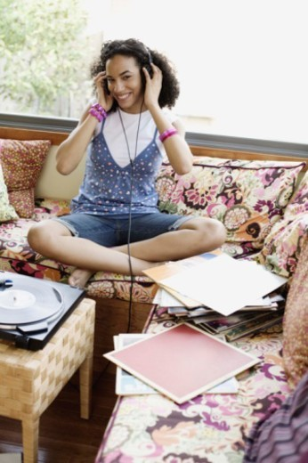 Teenage girl listening to headphones : Stock Photo
