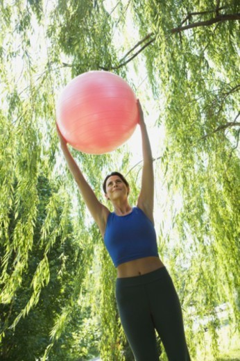 Woman with an exercise ball : Stock Photo