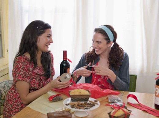 Women wrapping food : Stock Photo