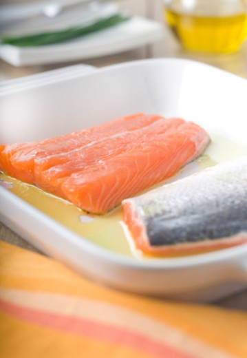 raw salmon, raw fish, baking, fresh fish, seafood, salmon skin, olive oil : Stock Photo