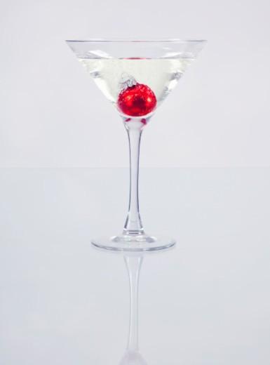 Stock Photo: 1555R-345736 Single red ornament in a martini glass symbolizes celebration