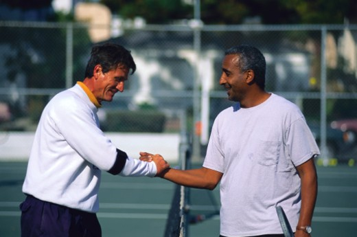 Stock Photo: 1555R-36001 Men shaking hands on tennis court