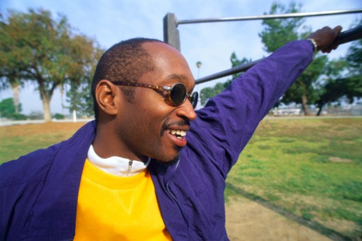 Stock Photo: 1555R-36080 Man smiling outdoors in sunglasses