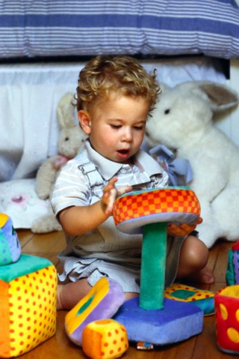 Stock Photo: 1555R-38003 Boy playing with toy
