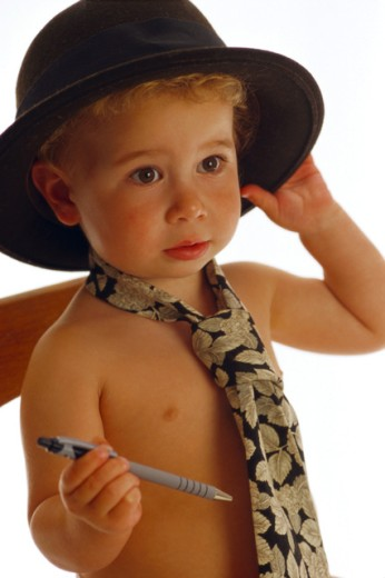 Boy in a hat and tie : Stock Photo