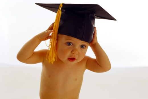 Stock Photo: 1555R-38092 Toddler in graduation cap