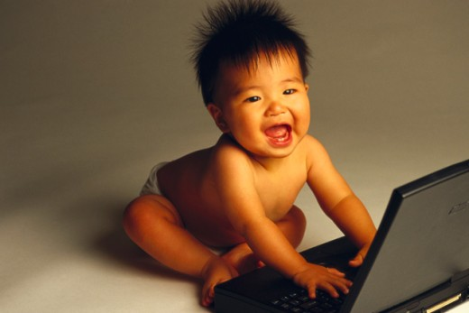 Stock Photo: 1555R-39081 Baby with a laptop