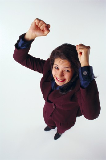 Stock Photo: 1555R-4050 Successful woman with fists raised