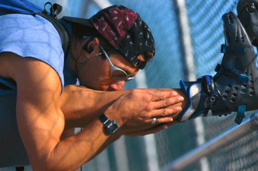 Stock Photo: 1555R-43037 Inline skater stretching outdoors
