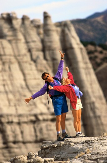Stock Photo: 1555R-43079 Couple celebrating on mountaintop