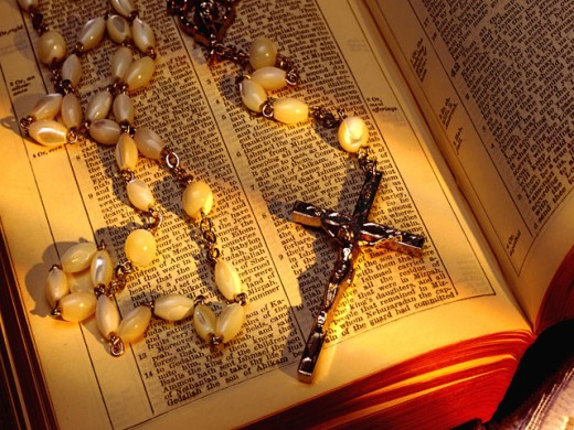 Rosary beads with crucifix and Bible : Stock Photo