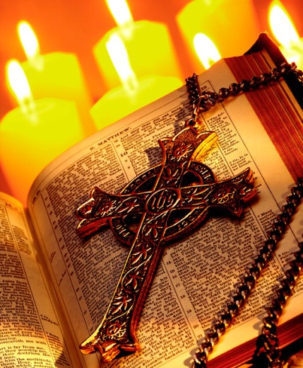 Cross with Bible and candles : Stock Photo
