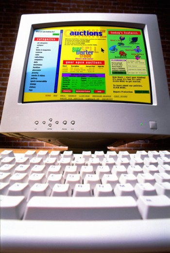 Computer with auction website : Stock Photo