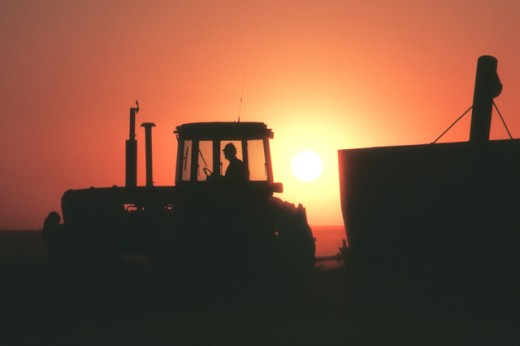 Silhouette of farm equipment : Stock Photo