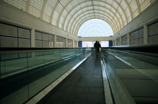 Tunnel with moving walkway : Stock Photo