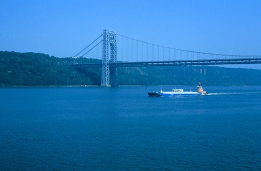 Stock Photo: 1555R-69023 Tugboat under a bridge