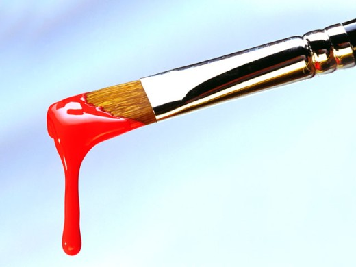 Brush dripping with paint : Stock Photo
