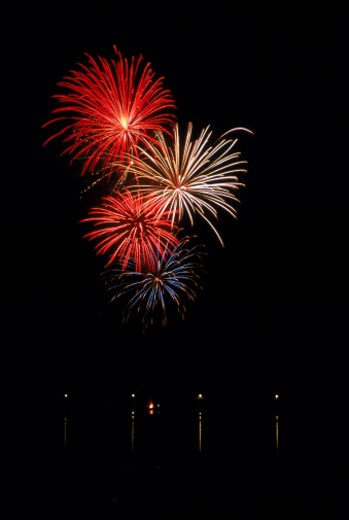 Stock Photo: 1555R-99090 Fireworks display over water