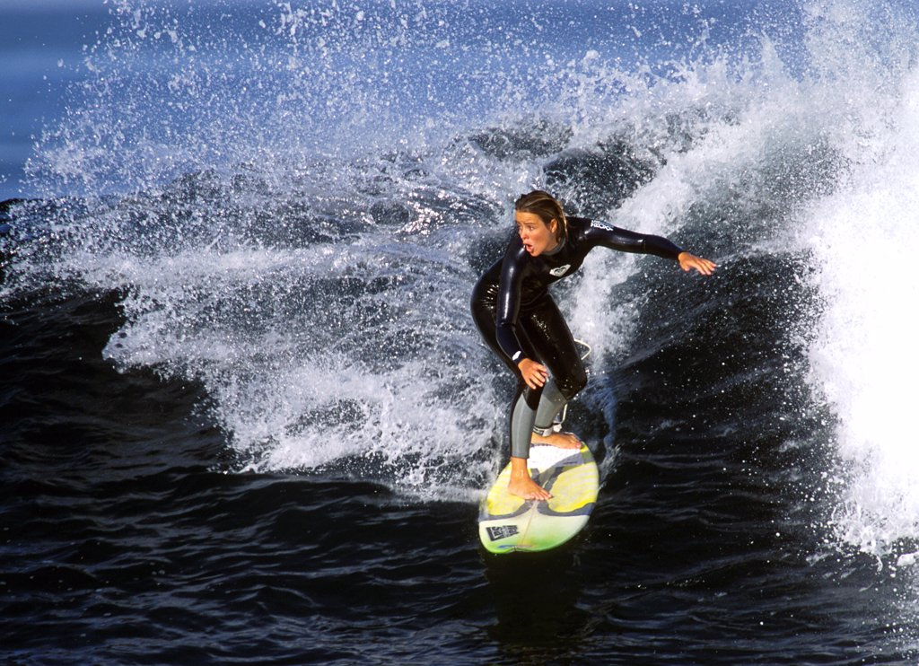 Stock Photo: 1556R-0104 Young adult woman surfing, Lanzarote, Canary Islands