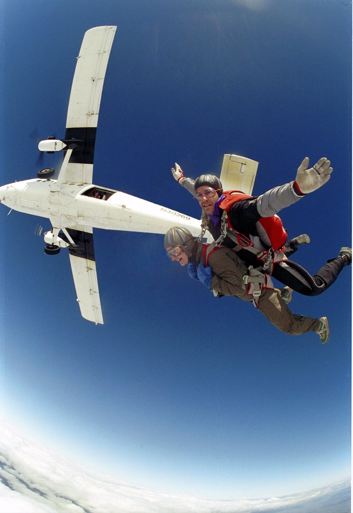 Stock Photo: 1556R-0194 Two people skydiving (fish-eye lens)