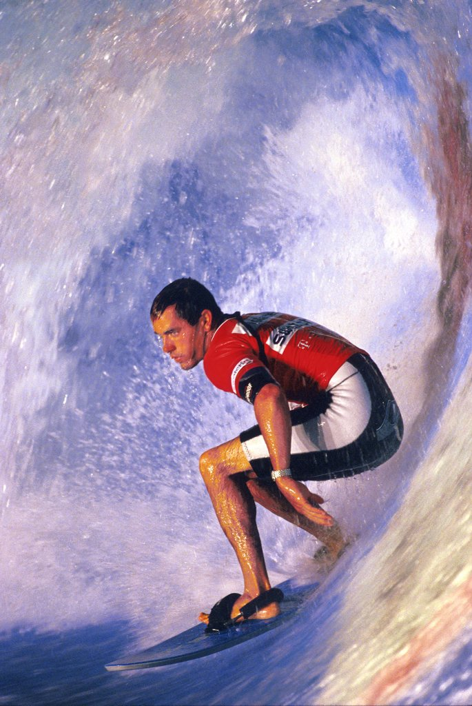 Young adult man surfing : Stock Photo