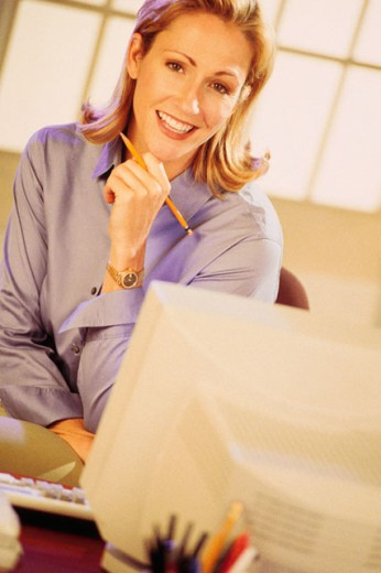 Stock Photo: 1557R-0112 Woman at home office