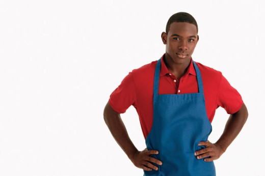 Stock Photo: 1557R-01444 Teenage boy wearing apron