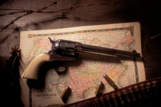 Colt Peacemaker with ammo : Stock Photo
