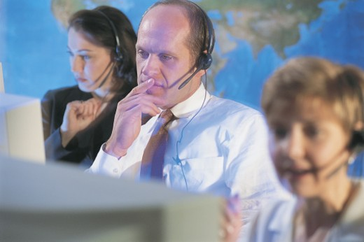 Stock Photo: 1557R-02549 Telemarketer with hands-free headset