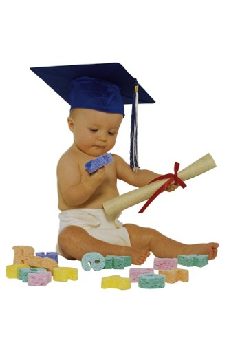 Stock Photo: 1557R-0274 Baby with toys wearing graduation cap and holding diploma