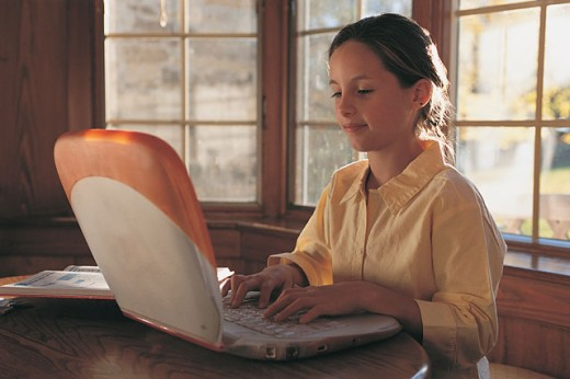 Stock Photo: 1557R-02800 Girl using a laptop
