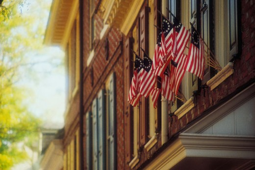 Stock Photo: 1557R-0345 American flags on building
