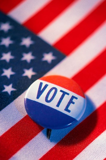 Stock Photo: 1557R-0346 Vote button on american flag