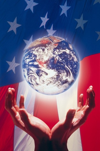 Stock Photo: 1557R-0353 Hands and globe against American flag