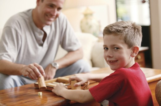 Stock Photo: 1557R-03671 Father and son playing backgammon together